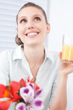 Young Woman Holding Juice Glass Stock Image