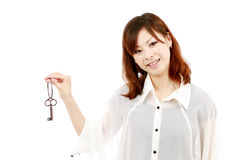 Young woman holding a key Royalty Free Stock Photo