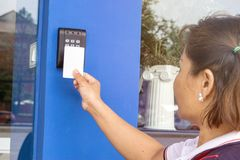 Young woman holding a key card to lock and unlock door stock photography