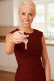 Young Woman Holding Keys To New Home Stock Image