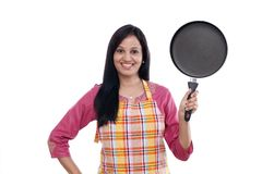 Young woman holding kitchen utensil Stock Image
