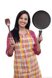 Young woman holding kitchen utensil Royalty Free Stock Images