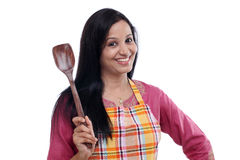 Young woman holding kitchen utensil Royalty Free Stock Photo