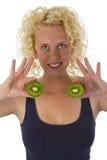 Young woman holding Kiw Fruit Stock Photos