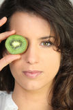 Young woman holding a kiwi Stock Photos