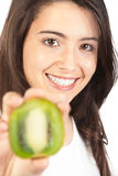 Young woman holding a kiwi Royalty Free Stock Images