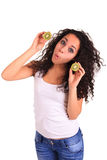 Young woman holding kiwi. Isolated over white. Isolated over whi Stock Images