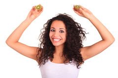 Young woman holding kiwi. Isolated over white. Isolated over whi Stock Photography