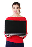 Young woman holding laptop Royalty Free Stock Images