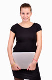 Young woman holding laptop computer. Young businesswoman holding laptop computer on isolated background Royalty Free Stock Photography