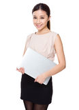 Young woman holding with laptop computer. Isolated on white background Stock Photography