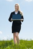 Young Woman Holding Laptop Stock Image