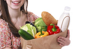 Young Woman Holding Large Bag of Healthly Groceries Royalty Free Stock Images