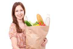 Young Woman Holding Large Bag of Healthly Groceries Royalty Free Stock Image