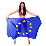 Young woman holding a large flag of the European Union Royalty Free Stock Photos