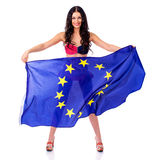 Young woman holding a large flag of the European Union Royalty Free Stock Photo