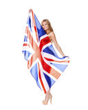 Young woman holding a large transparent British flag Royalty Free Stock Images