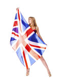 Young woman holding a large transparent British flag Royalty Free Stock Photography