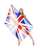 Young woman holding a large transparent British flag Royalty Free Stock Photo