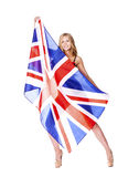 Young woman holding a large transparent British flag Stock Photography