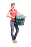 Young woman holding a laundry basket Royalty Free Stock Images