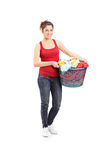 Young woman holding a laundry basket Stock Photo