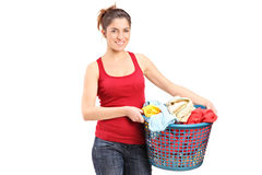 Young woman holding a laundry basket Stock Photography