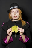 Young woman holding leaf Royalty Free Stock Image