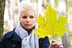 Young woman holding leaf Stock Photo