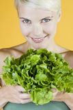A Young Woman Holding A Lettuce Royalty Free Stock Photography