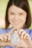 Young woman holding lightbulb Stock Photos