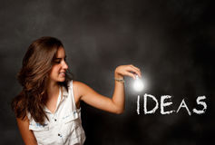 Young woman holding a lightbulb Stock Image