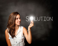 Young woman holding a lightbulb. Composing solution word Royalty Free Stock Images