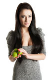 Young woman holding limes Stock Photo