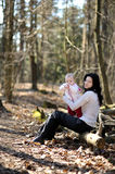 Young woman holding little baby girl Stock Image