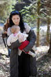 Young woman holding little baby girl Royalty Free Stock Photo