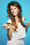 Young woman holding little present wrapped in blue Royalty Free Stock Image