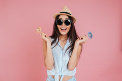 Young woman holding little toy umbrellas. Royalty Free Stock Image