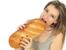 Young Woman Holding a Loaf of White Bread Stock Images