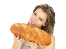 Young Woman Holding a Loaf of White Bread Stock Photo