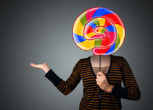 Young woman holding a lollipop Stock Image
