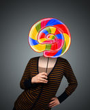 Young woman holding a lollipop Stock Photo