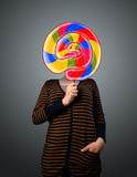 Young woman holding a lollipop Royalty Free Stock Photography