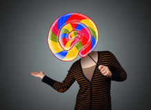 Young woman holding a lollipop Royalty Free Stock Images