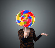 Young woman holding a lollipop Stock Photos
