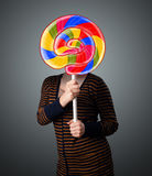 Young woman holding a lollipop Stock Images