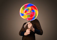 Young woman holding a lollipop Stock Photography