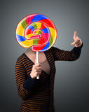 Young woman holding a lollipop Royalty Free Stock Photos