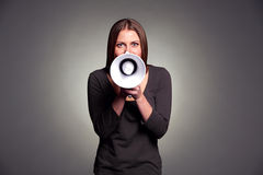 Young woman holding loudspeaker Royalty Free Stock Photography