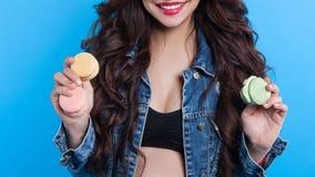 Young woman holding macaron Stock Photos